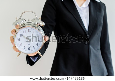 Clock on bussiness hand - stock photo