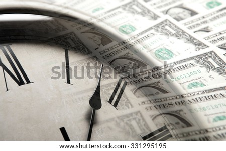clock on the background of banknotes dollars close up