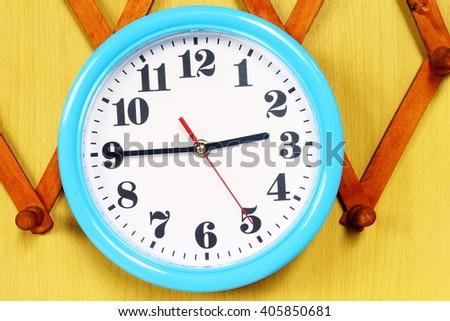 clock on the blue wall clocks - stock photo