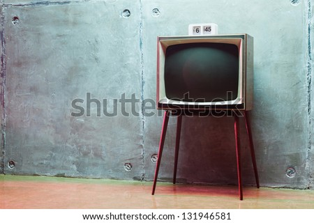 clock on the old TV in the studio - stock photo