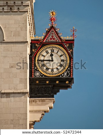 clock on the royal courts of justice - stock photo