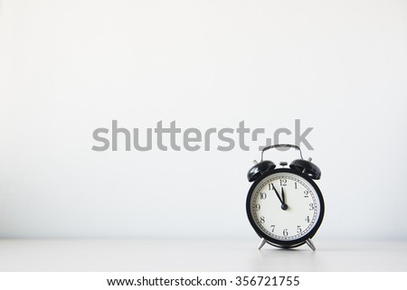 Clock on the table on white background