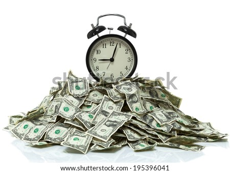 Clock on top of a pile of cash - stock photo