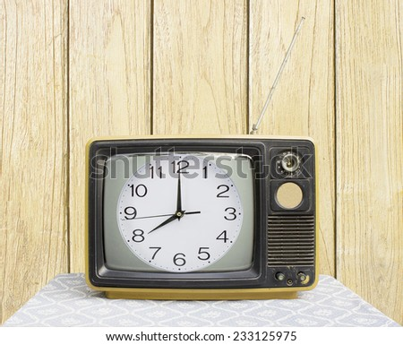 clock on Vintage TV - stock photo