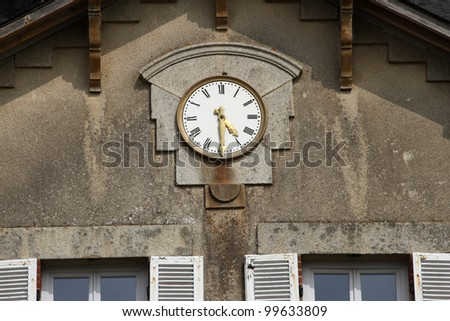 Clock on wall of historic french chateau mansion house - stock photo