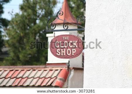 Clock Shop Sign - stock photo