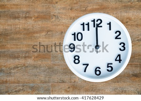 Clock show 12 am or pm on wood background with copy space. clipping path in picture. - stock photo
