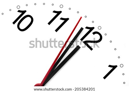 Clock showing a few moments before twelve o'clock - stock photo