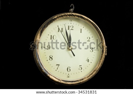 clock showing near midnight on white background