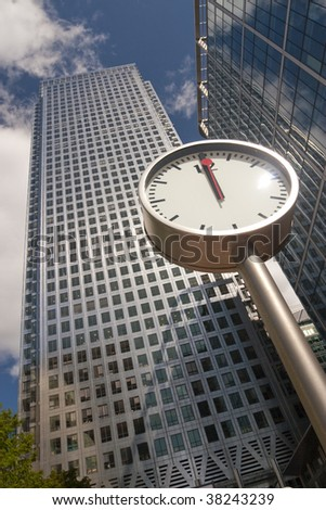 Clock showing noon in Canary Wharf, London - stock photo