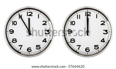clock showing time about twelve isolated on white. new year. - stock photo