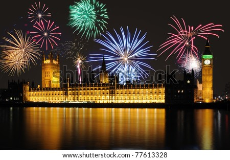 Clock shows midnight - fireworks above Big Ben / Parliament, London - stock photo