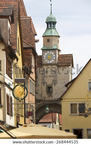 Clock tower and historical houses in Rothenburg ob der Tauber in Germany - stock photo