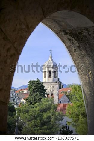 Clock Tower at Cavtat Harbor in Dalmatia, Croatia - stock photo