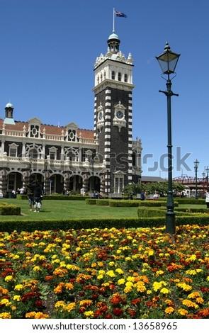 Clock tower at Dunedin Railway Station, New Zealand - stock photo
