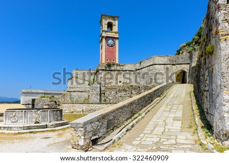 Clock Tower at Old Fortress of Corfu Town, Corfu Island, Greece. - stock photo