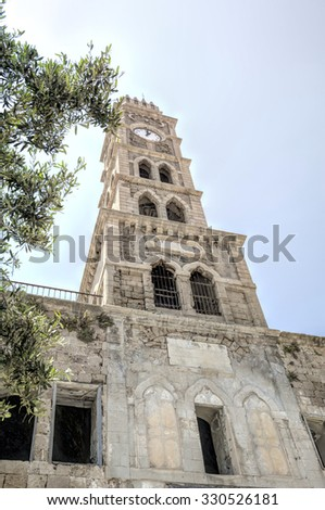 Clock tower in Acre Town.  Acre, the old city by the Mediterranean sea.   - stock photo