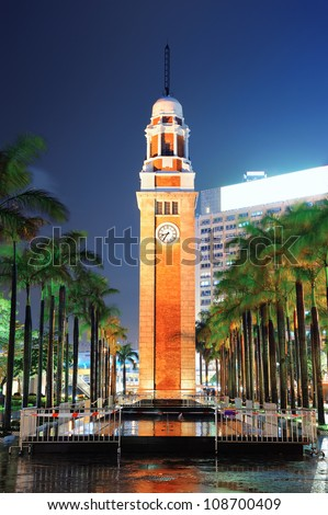 Clock tower in Hong Kong at night - stock photo