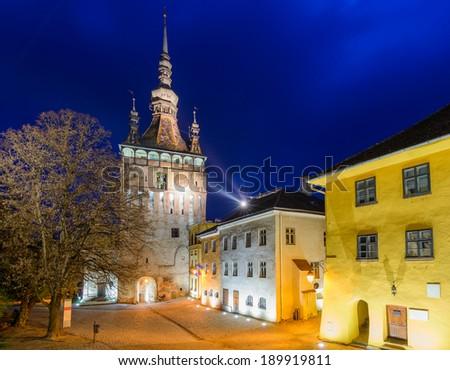 clock tower in sighisoara, transylvania, romania, at night - stock photo