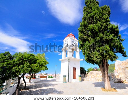 Clock tower in Skiathos, Greece against the blue sky - stock photo