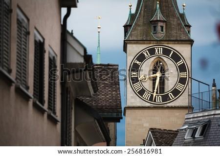 Clock tower in Zurich, Switzerland, close up - stock photo