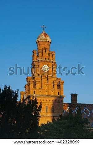Clock tower made from brown bricks of Chernivtsi State Univercity, Ukraine - stock photo