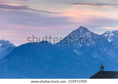 Clock tower near the mountains - stock photo