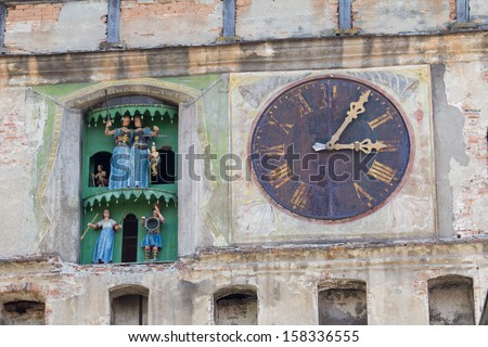Clock tower of Sighisoara Castle in Transylvania, Romania, birth place of Vlad Dracul - stock photo