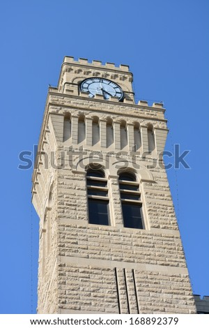 Clock tower of Sioux City Iowa City Hall building. - stock photo