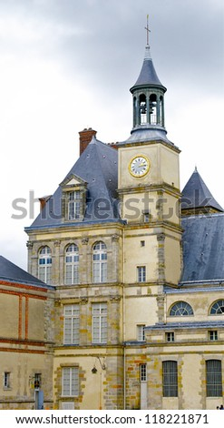 Clock tower of the Palace of Fontainebleau, one of the largest French royal chaÃ?Â??teaux. - stock photo