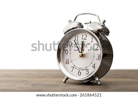Clock. Vintage background with retro alarm clock on table - stock photo