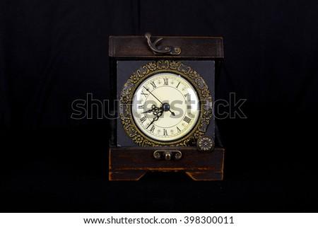 clock vintage ,vintage , watch on black ,vintage  clock on black ,vintage clock with white face ,wood clock ,old style clock ,time on watch ,clock, old, watch, style, vintage, times ,minutes,seconds - stock photo