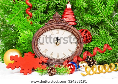 Clock with fir branches and Christmas decorations