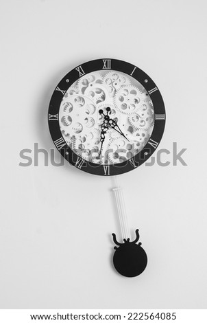 Clock with gears on white background - stock photo