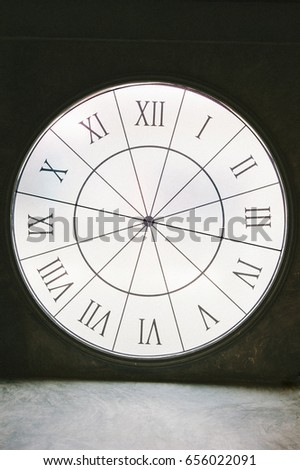 clock with roman numeral black and white tone for background
