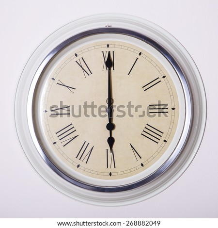 clock with Roman numerals at 6 o'clock - stock photo