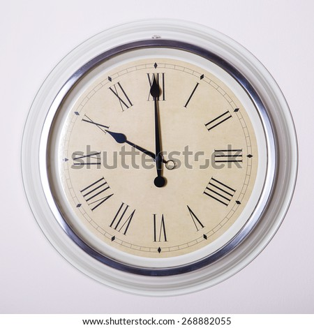 clock with Roman numerals at 10 o'clock - stock photo