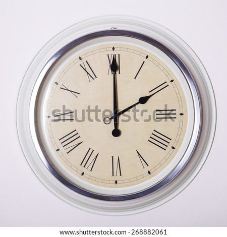 clock with Roman numerals at 2 o'clock - stock photo