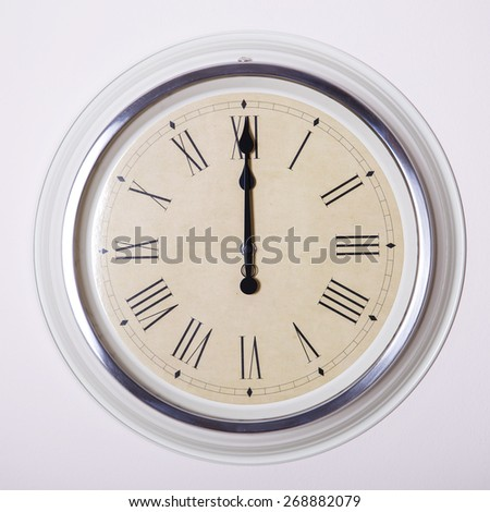 clock with Roman numerals at 12 o'clock - stock photo