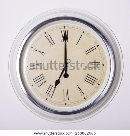clock with Roman numerals at 7 o'clock - stock photo