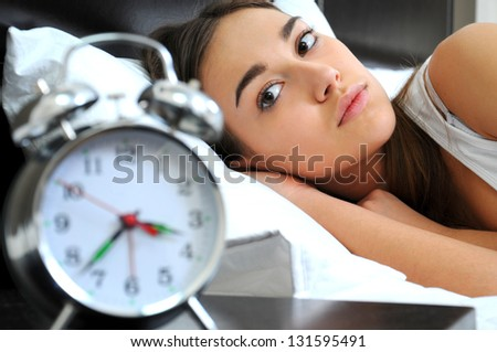 Clock with sleep at night. Woman can not sleep. - stock photo