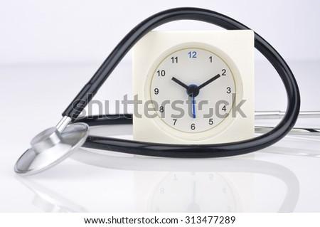 Clock with Stethoscope, Selective Focus  - stock photo