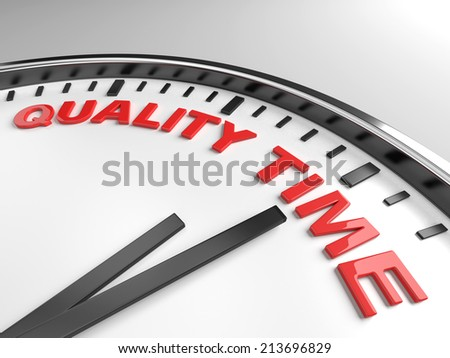 Clock with words quality time on its face - stock photo