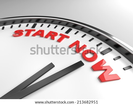 Clock with words start now on its face - stock photo