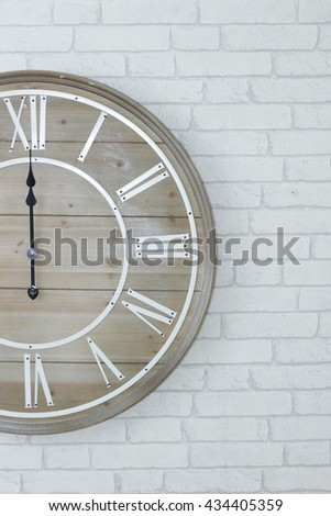 clock wood on  brick white wall