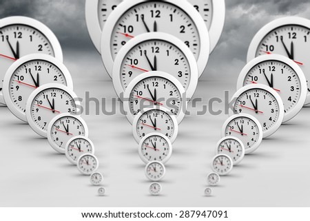 Clocks against stormy sky background