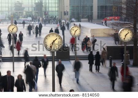 clocks in london's docklands - stock photo