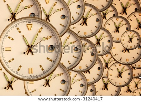 Clocks receding into background - stock photo