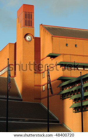 Clocktower of the British Library, Euston, London, England, UK, catching the warm late afternoon winter sun - stock photo