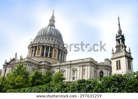 Clocktowers and dome of St Pauls Cathedral in London England under sunny skies - stock photo